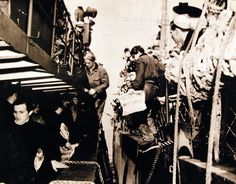 Crew of German submarine, U 858, which surrendered to units of Atlantic Fleet are transferred from a DE to a U.S. tug which met the U boat and her escorts 50 miles over Cape May, New Jersey. They were taken to internment at Fort Miles, Delaware Bay. Photograph released May 10, 1945. U.S. Navy photograph, now in the collections of the National Archives.