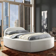 @Overstock - This eye-catching upholstered bed is sure to be noticed with its soft, pronounced curves. The rounded edges of the headboard complement the fully upholstered sides and footboard of the bed that also double as ultra comfortable seating.http://www.overstock.com/Home-Garden/Dorchester-White-Bonded-Leather-Queen-Bed/6910643/product.html?CID=214117 $629.99