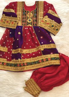 Afghan traditional dress for young girl. #afghandress #afghanfashion #afghanculture #fashion #eid #ramadan #style #dress #afghangirl #gifts #red #purple
