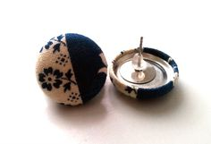 Floral and navy blue color block button earrings. $5.00, via Etsy.
