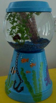 Flower pot, fish bowl and  voila you have a bubble gum dispenser looking fish bowl.