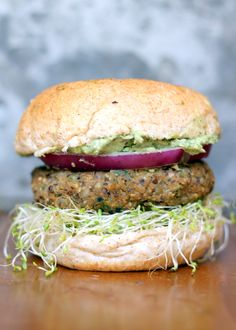 Spicy Sweet Potato Black Bean Burgers with avocado-cilantro crema + sprouts from Ambitious Kitchen. This whole combination has my mouth watering! #HealthyEating