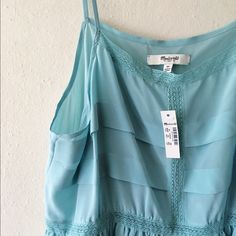 NWT Madewell silk peplum cami New with tags. Silk with soft pleats, fits true to size. Size medium. Madewell Tops Tank Tops