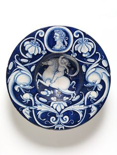 Broad-rimmed bowl painted in blue with a naked boy holding a sail on a galloping horse, Deruta, probably painted by Nicola Francioli called Co, tin-glazed earthenware Ceramic Painting, Ceramic Art, Italian Pottery, Blue And White China, Pottery Designs, Glazes For Pottery, Objet D'art, Victoria And Albert Museum, Earthenware