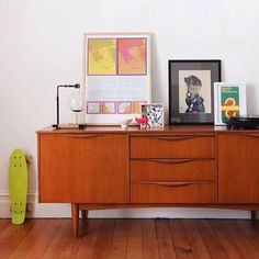 Art over a mid century modern credenza