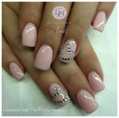 Nude pink with hearts made of rhinestones on ring fingers.