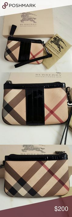 """Burberry Nova Wristlet Never used. Was going to give as a gift but ended up hitting something else. Has some marks on the inside from the tissue paper. Never used. The exterior of this wristlet is in good condition. There are a few small marks present on the fabric. It ships with a designer dust bag.  Size Width 6.5"""" Height 4.0"""" Depth 0.5"""" Coated Canvas, patent leather  Color: Multi, Beige Includes: Dust Bag and box Burberry Bags Clutches & Wristlets"""