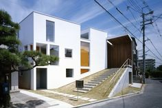 I- MANGO is an independent house for a single family, located in suburb of Osaka city. The site of this house adjoins the house of the client's parents, so establishing firm relationship between two houses is the key of this project.    By Takuro Yamamoto Architects