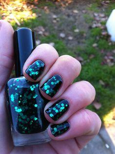 "Nail polish - ""Black forest"" emerald green glitter in a black jelly base. $10.00, via Etsy."