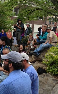 Flutist and washboard join the Asheville Drum circle.