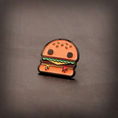Get your pin-game on and join the Pintastic Enamel Pin Club!  • Burger Boy soft enamel pin  • Comes with metal backing clasp  • .75 x .75  • Colors may slightly vary from image shown.  ____________________________   • Please review shipping & policies before purchasing.  www.andrew-heath.com