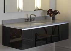 """60"""" W Deep Vanity with Night Light in Black featuring an under counter sink installation."""