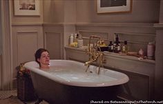 "Love the free standing tub and how the fixtures come out of the built-in shelving on the wall!  Get the free standing tub without the fixtures out on display and a shelf for holding necessary items.  Tour Jules' Home in Movie, ""The Intern"" with Anne Hathaway                                                                                                                                                                                 More"