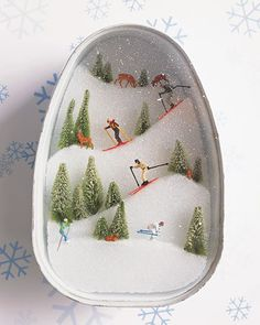 Ski Slopes Diorama... washed ham can thick Styrofoam cut slope shapes: bump chenille stems snow white glue and sprinkle with borax, or spatter on white paint. figurines from a model-train store, into position. Stretch plastic wrap over the container, and secure with a white rubber band.Using a toothbrush, spatter the plastic wrap with white paint for snow.