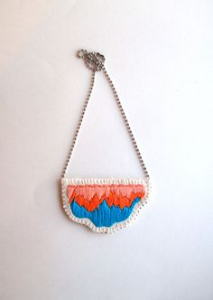 Embroidered pendant necklace abstract color combination of bright blue and ombre peach on a silver ball chain perfect for Spring