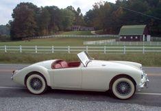 Adam Oüten's 1957 MGA Coupe in Old English White My year, but Black w/red! I miss that car! Bugatti, Lamborghini, Ferrari, Vintage Sports Cars, British Sports Cars, Vintage Cars, Antique Cars, Retro Cars, Old Fashioned Cars