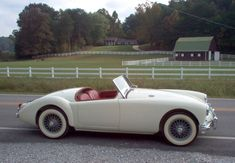 Adam Oüten's 1957 MGA Coupe in Old English White- WHY NOT? Id drive her with my fashion anywhere :)