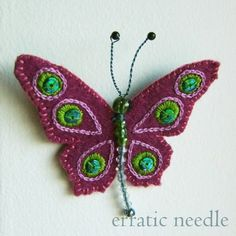 never though of felt wings for beaded bodies. would make a cool pin maybe