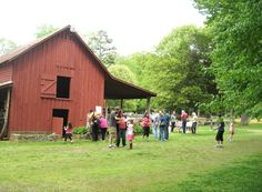 Visitors mill around the barn at Cedar Grove Windy Hill Farm, Cedar Grove, NC.