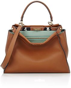 """Fendi Women's Peekaboo Satchel  Crafted of brown smooth leather, Fendi's Peekaboo satchel is styled at interior topline with a snakeskin-covered metal bar. Protective metal feet. Polished goldtone hardware. Lined with mint smooth leather. Zip pocket at two-compartment interior. Flat leather handle. Detachable, adjustable flat leather strap. Double turn-lock closure at topline. 10.00"""" height x 9.50"""" topline width/13.25"""" baseline width x 5.00"""" depth (approximately). 5"""" handle drop, 17"""" to 26""""…"""