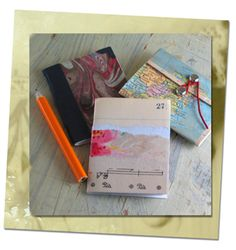 The first download includes basic instructions, paper recipes, and ideas for making mini books. The other downloads are templates for mini book covers and other decorative elements. The downloads are free.