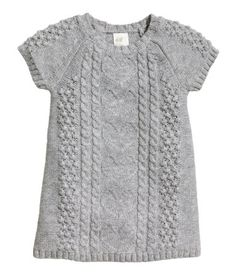 Short-sleeved knit dress in a cotton blend with wool content. Knit pattern at front and on sleeves. Buttons at back.