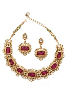 Amrapali gold necklace and earrings set with carved rubies and diamonds.