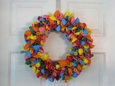 A cute idea for a birthday party. Instead of blowing them up, tie them together to make a festive wreath!