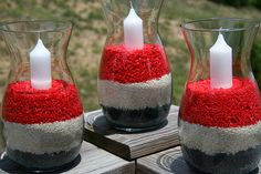 DIY: candle centerpieces...just fill vases with colored rice or sand then place a candle inside!