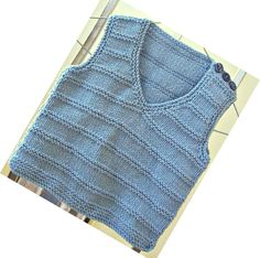 Hand knitted blue baby vest - fit boy about 6 months