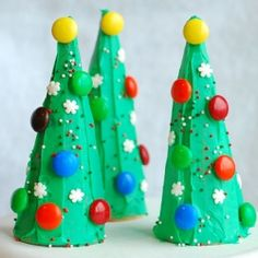 Ice Cream Cone Christmas Trees  Create pint-sized Christmas trees that are perfect for little hands. Turn sugar ice cream cones upside down, cover with green frosting and have your little elves decorate with candies and sprinkles to create an edible craft that is just as fun to eat as it is to make.  Check out these easy to make edible Christmas crafts for kids!