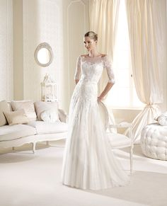 Love the belt on this one. La Sposa Bridal Dresses http://www.weddingchicks.com/2013/11/20/la-sposa-bridal-dresses/