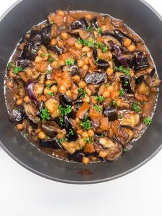 Maghmour is a delicious Lebanese Eggplant vegan dish made with eggplants, tomatoes, onions and chickpeas. It's the perfect dinner or side!