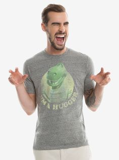 """<div>T-Rex's might have big heads and small arms, but that doesn't stop them from being huggers, especially Rex! This short sleeve grey crewneck features our friendliest dinosaur toy, and will let everyone know you're here for the hugs.</div><div><ul><li style=""""LIST-STYLE-POSITION: outside !important; LIST-STYLE-TYPE: disc !important"""">55% cotton; 32% polyester; 13% rayon</li><li style=""""LIST-STYLE-..."""