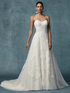 7941ff1b727 DORTHEA-Boho lace motifs drift from bodice to skirt in this tulle A-line  wedding gown