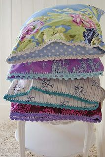 beautiful pillowcases in purple, lavender, teal...i could possibly make similar ones...just need to find the fabric