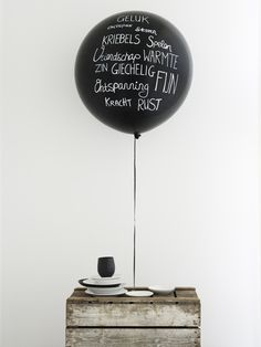 names of guests at each table written on balloons