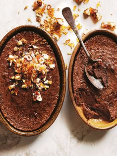 Chocolate And Hazelnut Praline Impossible Pie | Donna Hay1⅔ CUPS (410ML) MILK ¼ CUP (25G) HAZELNUT MEAL (GROUND HAZELNUTS) 6 FRESH DATES (120G), PITTED 50G UNSALTED BUTTER, MELTED 1 TABLESPOON VANILLA EXTRACT 2 EGGS ⅓ CUP (50G) PLAIN (ALL-PURPOSE) FLOUR 2 TABLESPOONS DUTCH COCOA ½ CUP (110G) CASTER (SUPERFINE) SUGAR 100G DARK CHOCOLATE, MELTED HAZELNUT PRALINE  ½ CUP (110G) CASTER (SUPERFINE) SUGAR 2 TABLESPOONS WATER ½ CUP (70G) HAZELNUTS