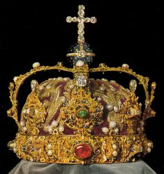 Royal Crown of Sweden.  The Crown of Sweden as it was before 20th century work restored it to its original 16th century appearance.  Sweden's Crown Jewels are kept deep in the vaults of the Royal Treasury, underneath the Royal Palace in Stockholm, in a museum which is open to the public. The symbols of Swedish monarchy have not actually been worn since 1907, but they are still displayed at weddings, christenings and funerals.