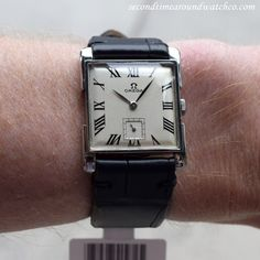 A 1946 stainless steel Omega Ref. 3813-4 square-shaped watch. This watch features unique, right-angle lugs, a silver dial with…