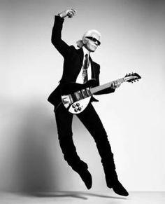 Karl Lagerfeld playing guitar