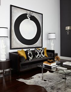 Atmosphere Interior Design | Living Room. lamps flanking art. color pallette. big impact.  who says a sofa against a wall is a no-no?!