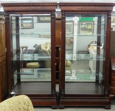 """Large curio cabinet wood and glass-lighted """"Howard Miller"""" Price: $1,200.00 each J0575 02 06/02/14 http://www.theguildshop.org/curio-cabinet"""