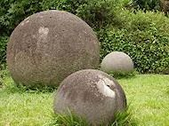 Around 300 pre-columbian spheres or petrospheres are scattered throughout Costa Rica. Some are over 2 meters in diameter and weigh up to 16 tons. They were made into near perfect shapes. Estimated age: 500-2200 years. Almost all of them are made of granodiorite. Locally, they are known as Las Bolas. Their purpose remains unknown.