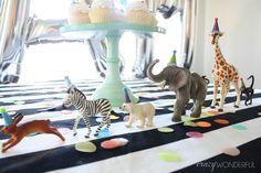 party animal themed birthday, plastic animals party hats, boy birthday party idea