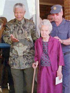 Former South African President Nelson Mandela with Betsie Verwoerd, widow of apartheid's architect Hendrik Verwoerd, in Orania in 1995.
