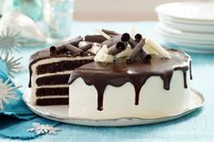 Tuxedo Cake Recipe - Black and White and delicious all over!  This gorgeous cake serves a crowd.