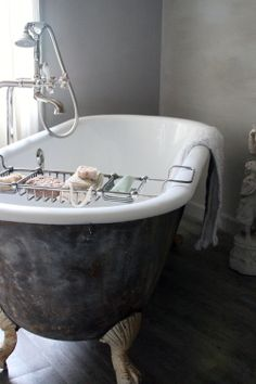 master bath claw foot tub with tray love it hunting for one of these in our area to replace the tacky plastic thing that we have nowthis is much more