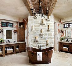Rough surfaces, natural nuances, and weathered patinas combine with polished finishes and fashionable fittings in these 18 rustic bathrooms that are sure to inspire.