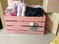 Baby crate. For my sissy's baby shower! Painted a cheap crate from michaels grey and put stencils from my cricut on top and painted over that with pink. Tadaaaaa